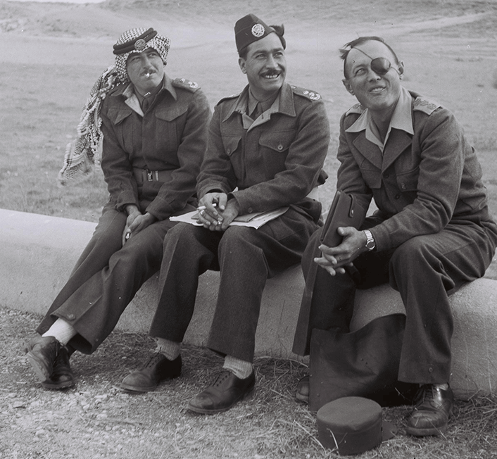 ALUF MISHNE MOSHE DAYAN (R) TALKING TO COL. MOITA (C) & COL. HINAWY OF THE ARAB LEGION AT THE